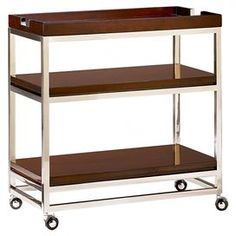 "Bar cart with a removable tray top and two shelves.    Product: Bar cartConstruction Material: WoodColor: BrownFeatures:  Removable tray topTwo shelves Dimensions: 32.25"" H x 31.5"" W x 16.5"" D"