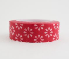 Single roll of washi masking tape with red flowers pattern. Great for travel journals, scrapbooking, gift wrapping, decorating cards and envelopes and more! Add a little dash of cuteness to any crafti