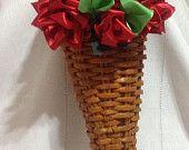 Cornupia con rose rosse di raso € 15,00