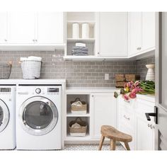 Love the greige subway tile backsplash and off-white cabinets in this laundry room. Tiffany Harris Design creates spaces of crisp white, rustic textures, lux materials, and modern lines that feel on-trend yet unique and timeless. Laundry Bin, Doing Laundry, Laundry Room Storage, Laundry Room Design, Laundry Cabinets, Kitchen Cabinets, Garage Cabinets, Island Kitchen, Kitchen Tiles