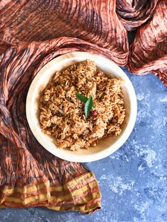 """Puliyogare or tamarind rice is a rice preparation famous in South India. In Karnataka, it is prepared by making """"gojju"""" or a spice mixture which is then mixed with cooked rice. If the puliyogare gojju is ready, this dish is ready in no time. The gojju stays good for up to six months when refrigerated. … Rice Bread, Dry Coconut, Love Eat, Curry Leaves, Tamarind, South India, Karnataka, Turmeric, Crisp"""