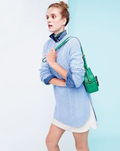 J.Crew women's tunic cable knit sweater in heather blue, Western chambray shirt, mini skirt in double-serge wool in ivory, striped bandana and Signet bag.