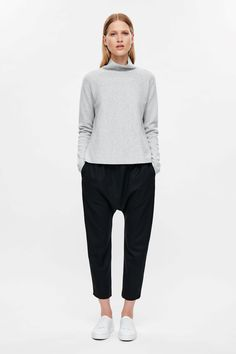 This high-neck jumper is made from a Milano knitted cotton with a melange  finish. An A-line fit 35c266233158a