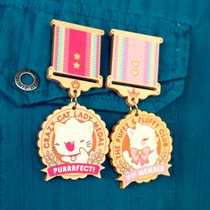 """Show off your awesome achievements with either a Crazy Cat Lady Medal or a Puffy & Fluffy Club Medal. Printed and cut on metallic gold acrylic. A pin back is glued on the other side to attach to your clothes, bags or any other material. Medal is approx 3"""". SPECIAL OFFER: All charms come wit..."""