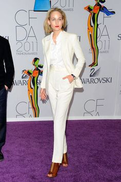 Leelee Sobieski wears an ivory Adam Kimmel suit. Shes definitely making a case for a high waisted pant blazer duo