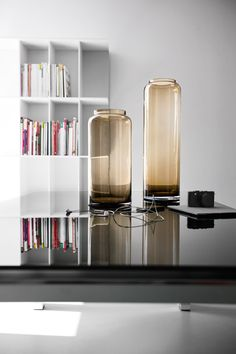 HONEY is a glass vase with a cylindrical shape, high and narrow. Its sleek design and the nuances of its games of lights and shadows recall the transparency of honey. Not just an ornamental object, it's also useful for holding flowers. #calligaris #toronto #vase