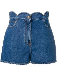 Shop Valentino denim shorts.