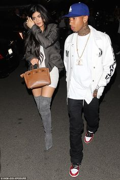It's back: She's said to have moved Tyga into her Calabasas home for the time being