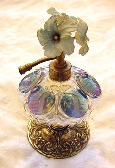 Vintage Art Deco 'Irice' Flower Rhinestone Perfume Bottle w' Atomiser (missing pump) & Blue w/ Purple iridescent Art-Glass ✿≻⊰❤⊱≺✿ Perfume Atomizer, Antique Perfume Bottles, Vintage Bottles, Art Nouveau, Art Deco, Perfumes Vintage, Beautiful Perfume, Bottle Art, Antique Glass