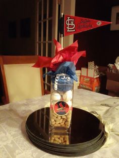 This is a centerpiece for our son's baseball themed bar-mitzvah. You can do this with any team. Baseball Party, Sports Party, Baseball Stuff, Baseball Centerpiece, Baseball Decorations, Centerpiece Ideas, Bar Mitzvah Party, Bat Mitzvah, Grad Parties