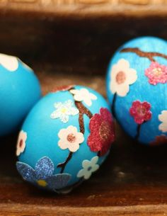 Decorate Easter eggs with pretty stickers.