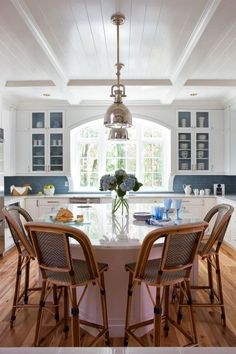 Gorgeous window and pretty blue tiles - Celia Welch dine in kitchen island, on Centsational Girl