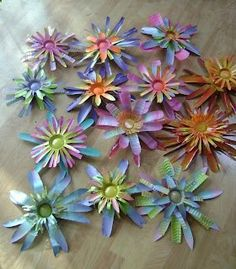 spray painted flowers from alumium soda or beer cans - if the edges arent too sharp, I may do this - hate to see so many cans getting thrown away - garden art - Adventures of the Art Junk Gypsy: Garden Art