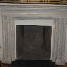 """Decorative Items - A 19th century , English , painted fire surround , retaining the original paint , of pleasant proportions , and in the neoclassical taste .Measurements:  68"""" Wide  x  10"""" Deep  x  50"""" High InsideMeasurements:  38""""  x  38"""""""