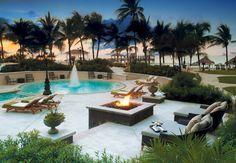 Firepits light the evening at the resort's Balmoral Pool.