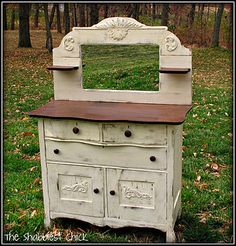 dresser with mirror.... I like how all of it is painted but the shelves/tabletop