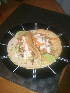 Cajun chicken/shrimp tacos with slaw and lime drizzle with a kick. Recipe provided by the snyder sisters :)