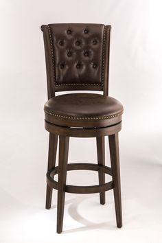Features:  -Upholstered in brown vinyl (Faux leather).  -Constructed of wood and wood composites in a brown cherry finish.  -Bronze studded brown faux leather upholstery on the back.  -Chiswick collec