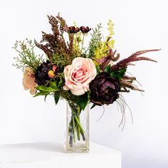 Abigail Ahern Walton Faux Bouquet: Beautiful faux bouquet by Abigail Ahern. Blush roses, heather, veronica, viburnum, cosmos and plum peonies bring all their beauty to this fabulous hand-tied bouquet. This is a 360-degree bouquet and looks lovely from every angle.   The vase shown in the photo is not included.  We pride ourselves in featuring the most naturalistic faux flowers and botanicals - they're seasonal, high quality and beautifully realistic. We favour natural and organic over…
