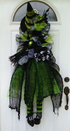 Wicked witch wreath.  Great for Halloween!  Get it at Wreaths by Rita.