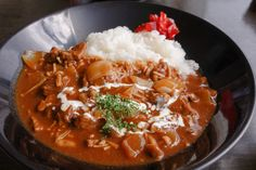 Hayashi rice - a Western-style Japanese dish of beef, onions and button mushrooms in a thick demi-glace sauce on rice occasionally topped with a drizzle of fresh cream.