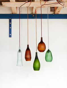 Pendant lighting by Ruth Allen, made out of recycled beer and wine bottles. Photo by Sean Fennessy.