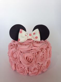 Minnie Mouse smash cake with pink rosettes, ear and bows