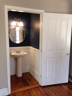Powder room renovation! I love how the navy blue looks in this small bathroom.