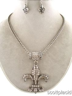 "CHUNKY 62MM LONG FLEUR DE LIS PENDANT SILVER TONE METAL NECKLACE SET WITH CRYSTAL ACCENTS        * If you need a necklace extender I have them for sale in my store.*        HOOK EARRINGS         LOBSTER CLAW CLASP        NECKLACE: 16"" + 3"" ext       COLOR: GREY AND SILVER TONE $20.99"