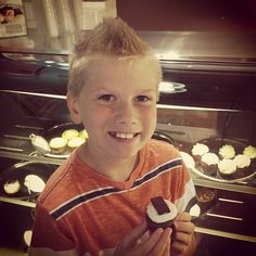 """Meet Brandon. He named Oh My Cupcakes! Today, he's in creative mode, making up new creations. This one might be a winner! He calls it """"Candemonium"""" #ohmycupcakes"""