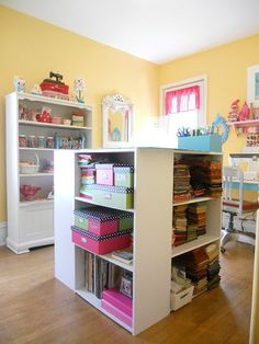 where every single thing has a place… « Cornbreadandbeansquilting's Weblog Cutting table made from 4 inexpensive bookcases. The white hutch came from a thrift store with a worn finish. Now it looks great!