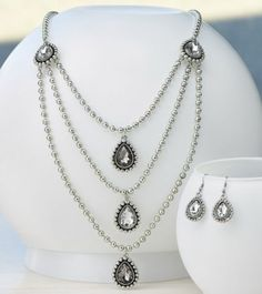 Teardrop Crystal 3-Strand Necklace and Earring Set from Monroe and Main.     Clear and smoky crystals.