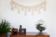 Handmade Macrame Bunting Hang it on your wall, in your window or above your babys cot - Anywhere!!!  This modern take on the popular 70s art of a macrame is made from 6mm diameter natural cotton rope.  It is approximately 130cm (51) wide and 27cm (10.5) long. It is strung to rope with extra rope on the sides and can be easily hung as you wish. Each piece is made to order so please allow up to 3 weeks for shipment. As each piece is hand made there may be slight variations.  Custom orders are…