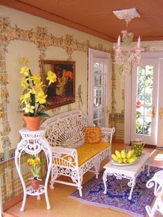 The Garden Room of Robin Carey's Key West Island Dollhouse depicts the passion for raising orchids. On the tables are bananas and slices of Key Lime pie, the most popular desert on the island. Image via www.dollhouseminis.blogspot.com