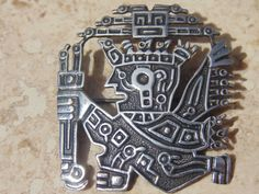 This sterling silver pendant was made in Peru. It is well made and in good vintage condition