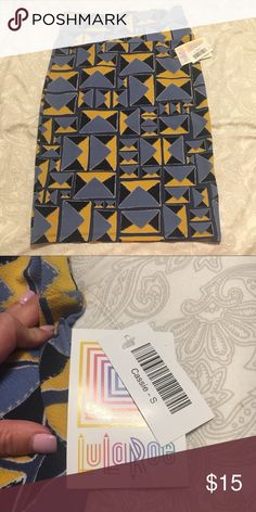 NWT LulaRoe Cassie Beautiful pale blue, yellow and gray geometric print. Never worn! Soft material, not silky. Very forgiving! LuLaRoe Skirts
