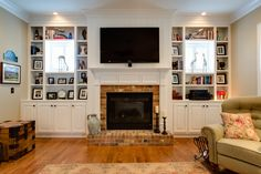 fireplace windows. bookcases built out around windows Wando View Home in Daniel Island  SC by JacksonBuilt Custom Homes Like the grid on shelves Bookcases shallow fireplace stuff Pinterest