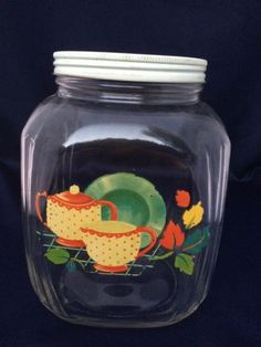VINTAGE-ANTIQUE-GLASS-COFFEE-JAR-WITH-PAINTED-WITH-DISH-FLOWER-PATTERN-METAL-LID-$32.50.