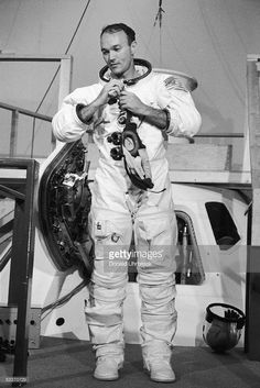 American astronaut Michael Collins putting on his flight suit during final training for the Apollo 11 moon mission.