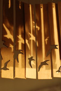 Laser cut birds and shadows on wooden lampshade