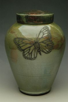 A simply designed dragonfly urn hand-thrown in the Japanese earthenware style of Raku. With choice of colored glaze finish, this pottery urn will honor your loved one with a timeless memorial urn.