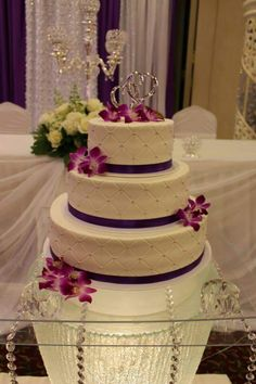 3-tier wedding cake with our quilted pattern, mini orchids and a double heart topper. www.mitchels.ca #wedding #weddingcakes #3tier #flowers #orchids