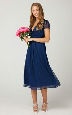 34bf9d04da861 Special occasions were made for special dresses, and this navy midi dress  proves the point impeccably.