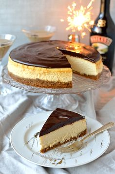 Smooth, creamy Baileys Irish Cream baked cheesecake with gingersnap crust and Baileys chocolate ganache topping.