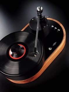 "Stunning turntable design by AMG (Analog Manufaktur Germany), called Viella 12.        ""Precision engineering and classic design are embodied in the first turntable from AMG (Analog Manufaktur Germany), the Viella 12 or simply, V12. The AMG turntable line was created by a group of audio industry experts to advance the art of vinyl playback"
