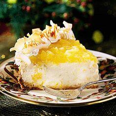 Festive Piña Colada Cheesecake - To-Die-For Cheesecake Recipes - Southernliving. Recipe:Festive Piña Colada Cheesecake  Crushed pineapple, coconut, and a little light rum give this easy piña colada cheesecake its Caribbean flair.