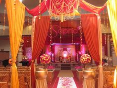 mandap and aisle decor, red and yellow wedding #indianwedding, #shaadibazaar