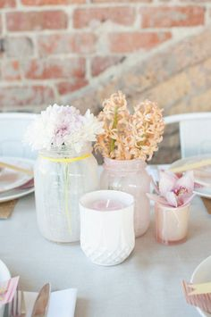 lovely simple centerpiece; i want all my stuff to be diy (thrift store vases/teacups filled with flowers & handmade candles)