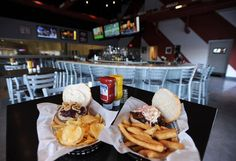 (L to R) These are the 'If You Love Onion Burger' and the 'Local Stryker Farm BBQ Pulled Pork Sandwich' with homemade Coleslaw and Boardwalk style fries served at the Steel Pub in Bethlehem.