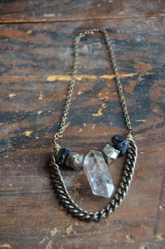 Spark & Thistle- ETSY. Rustic Quartz Necklace- Tibetan Quartz Crystal- Pyrite- Tourmaline- Bronze- Chain-Tribal-Industrial-Rustic-Boho-Hippie-Gypsy-Goth- Punk. via Etsy.